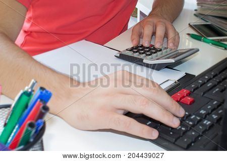 Businessman pressing computer button - financial analyzing concept. Finance Business and accounting business