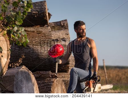 Lumberjack With Chainsaw On Trunks