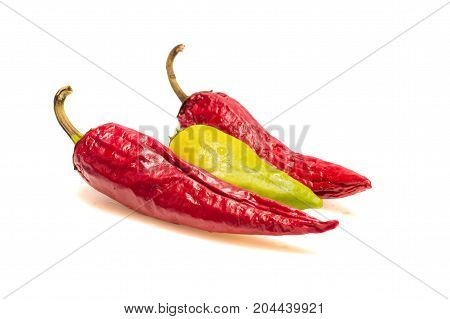 different peppers on a white background one stands out