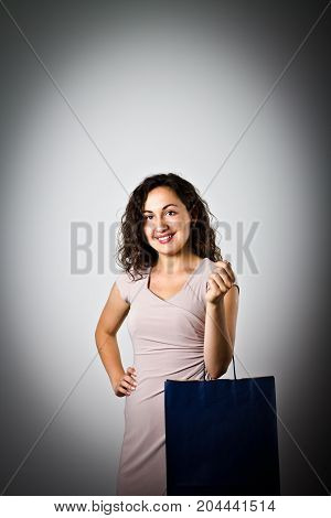Happy girl with paper bags. Shopping time.