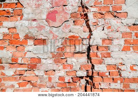 Crack In The Old Wall. Wear Of Brick Masonry. Background.