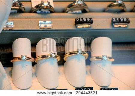 Solitaire Diamond engagement rings in a shop window