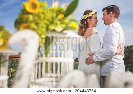 Happy newlyweds couple in marriage, wedding ceremony with flowers decorations in Ubud. Wedding proposal.
