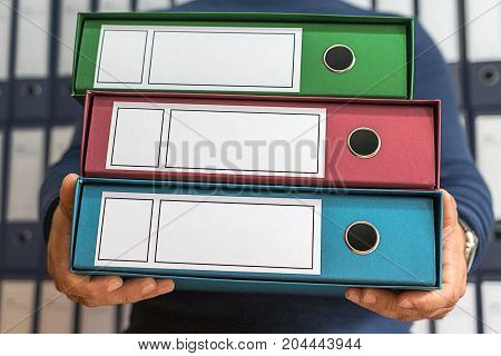 Businessman with corporate files in document binder blank label as copy space