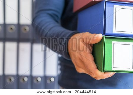 Ring Binder corporate files in document binder.
