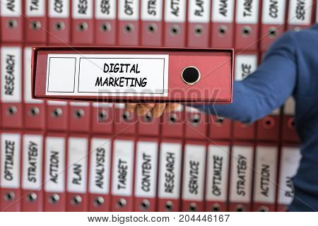 Marketing technology concept. Digital marketing. Young man holding ring binder.