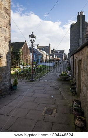 A quiet North Square walking street with old granite houses next to the sea and beach in Aberdeen city