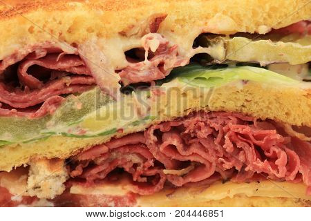 A fresh pastrami sandwich: charcuterie lettuce pickles and mayonaisse
