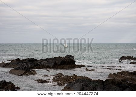 Yacht sailing in Banff Bay near MacDuff town coast in Scotland