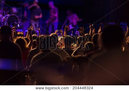 Fans Watching A Band Perform On Stage