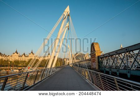 Golden Jubilee And Hungerford Bridges In London Early In The Morning