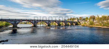 Scenic arched West Bridge across River Tay in Perth city Scotland