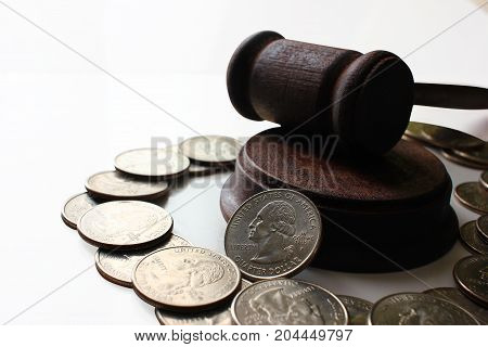 Hammer of a judge on a heap of dolor coins, a legal right