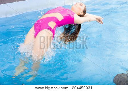 Beautiful Woman Swimming In Pool