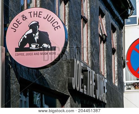 Reykjavik Iceland August 22 2017: Joe and The Juice sign is attached to the wall above the entrance to the coffee shop.