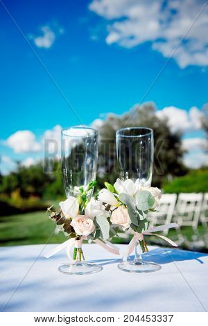 Wedding glasses at the banquet on a white table