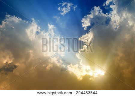 Sky blue and orange light of the sun through the clouds in the sky survive.