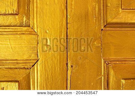 The golden wood door texture for background.