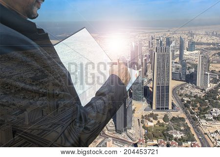Business man with book writing job on city background