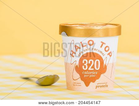 DALLAS TEXAS - SEPTEMBER 15 2017: A pint of Halo Top a high-protein low-sugar and low-calorie Ice Cream in sea salt caramel flavor. The diet-friendly Halo Top Creamery ice cream was launched in 2012.