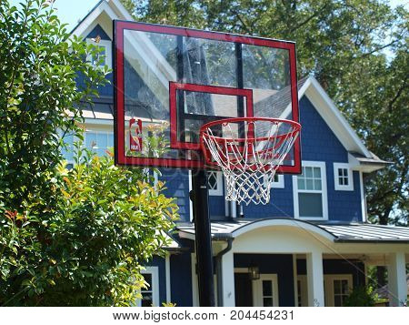 Dallas, USA, 16 September 2017.A driveway hoops backboard and net for basketball play was at the edge of this driveway for practice  in Dallas, 16 September