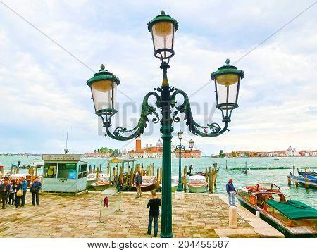 Venice, Italy - May 04, 2017: gondola sails down the channel in Venice, Italy. Gondola is a traditional transport in Venice, Italy