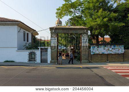 POMORIE BULGARIA - AUGUST 18 2017: Orthodox monastery of St. George. Central entrance from the street of Knyaz (Tsar) Boris I.