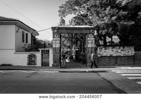 POMORIE BULGARIA - AUGUST 18 2017: Orthodox monastery of St. George. Central entrance from the street of Knyaz (Tsar) Boris I. Black and white.