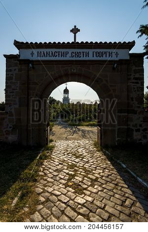 Entrance stone gate to the Monastery of St. George in Pomorie. Bulgaria.
