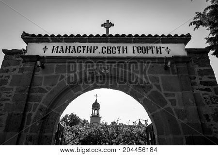Entrance stone gate to the Monastery of St. George in Pomorie. Bulgaria. Black and white.