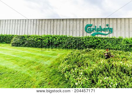 Northampton, UK - Sep 10, 2017: Wide angle daylight view of Carslberg logo on factory fence.