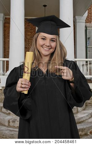 Young woman in her graduation robes or gown