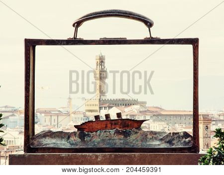 View of the Palazzo Vecchio through the metal frame with the boat Florence Tuscany Italy. Travel destination. Retro photo filter.