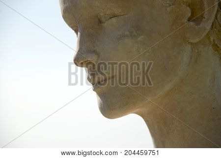 Face of a stone sculpture in Eze, France