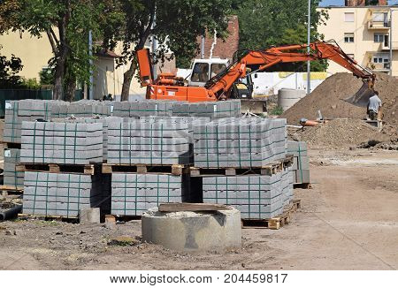 Excavator and construction materials at the road construction