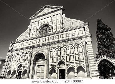 Basilica of Santa Maria Novella is the first great basilica in Florence and is the city's principal dominican church. Tuscany Italy. Black and white photo.