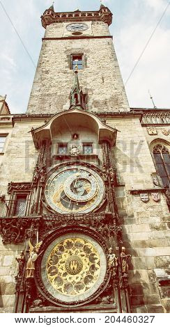 Old town hall with astronomical clock in Prague. Cultural heritage. Architectural theme. Retro photo filter.