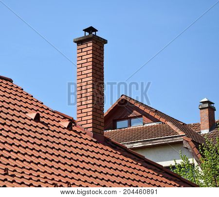 House roofs with smoke stacks in the city