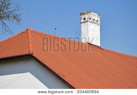 Red roof and smoke stack on the roof