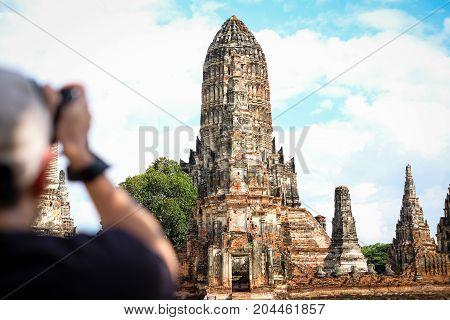 High prang in Khmer style with four smaller prangs construction on rectangular platform at Wat Chaiwatthanaram (Ayutthaya Province Thailand) - travel concept.