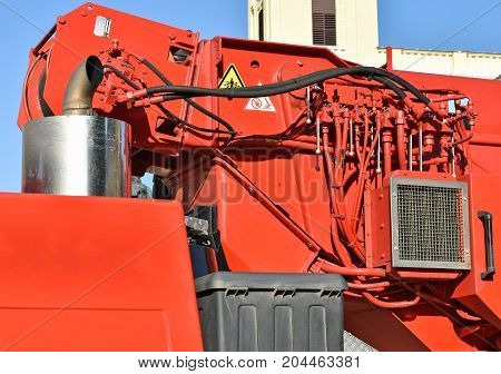 Part of a crane vehicle in the city