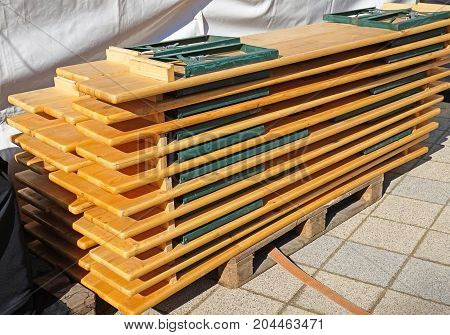Portable benches in a stack on a pallet outdoor