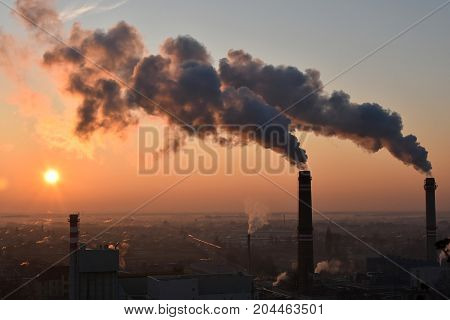 Smoking smoke stacks in the city in the morning