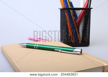 notebook and pen on white table. Selective focus.