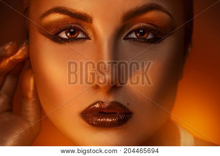 Close up portrait of pretty caucasian woman with brown eyes in studio