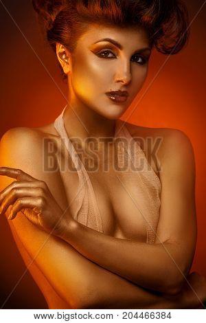 Sexual adult woman in bandage bra in studio