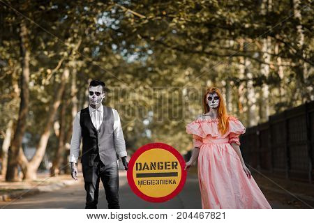 Take care of yourself from this both. Terrible outside. Day in park before the celebration Halloween party. Outdoors.