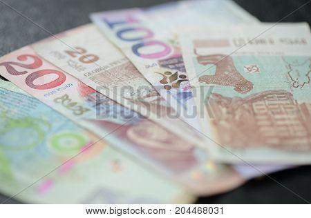 Some Banknotes Of Georgian Lari On A Dark Background