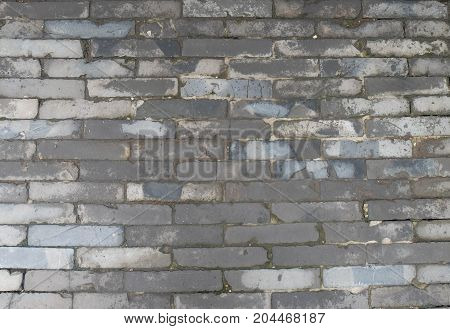 Weathered texture of stained old grey wall for background grungy rusty blocks of stone-work technology colorful horizontal architecture