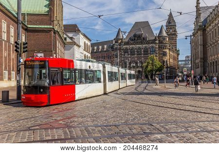 BREMEN, GERMANY - AUGUST 23, 2017: Tram going through a cobblestoned street of Bremen Germany